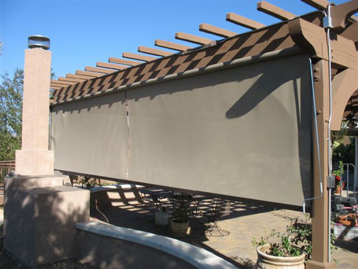 wooden pergola showing the screens that extend down